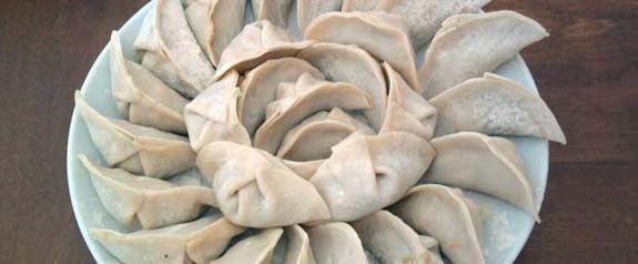 freshly prepared, uncooked dumplings