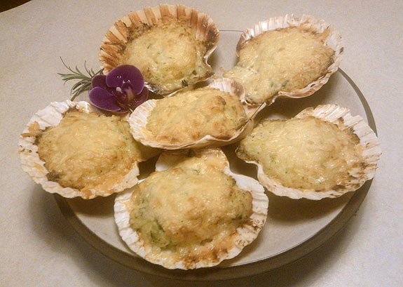Baked scallops with potato and cheese freshly cooked