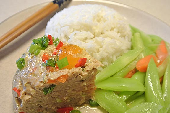 Steamed salty egg and pork mince is served with rice and greens